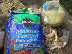 planting - bucket - Miracle-gro, sand, rocks 009