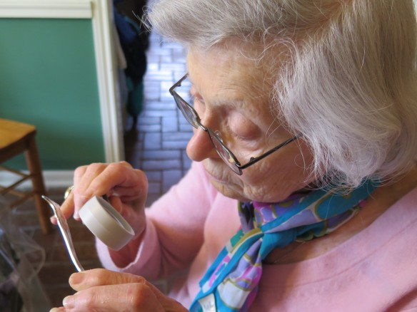 grandma inspecting Roger's silver spoon - IMG_2592_1