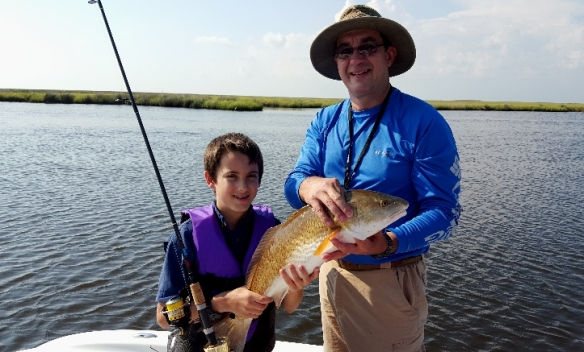 Cameron and Grandfather with redfish catch - 20150607_090350