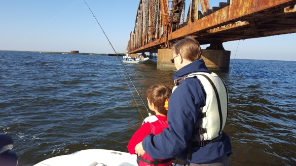 Dylan and Grandmother fishing at railroad bridge - 20151011_090630