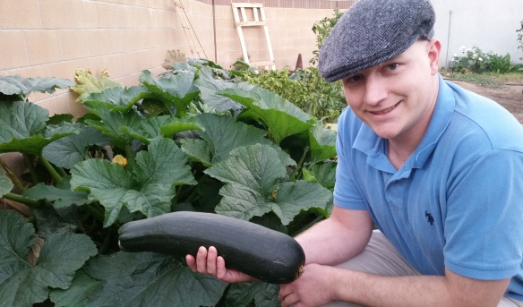 Nick with zucchini in his garden - 5 - 20151201_164515