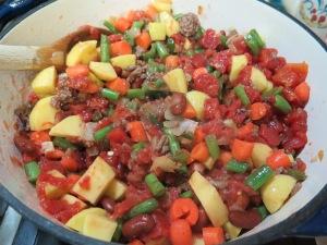 Add tomatoes and seasonings - IMG_6744