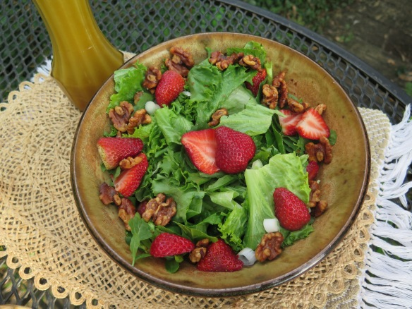 Salad with Salted Walnuts, Strawberrries, Arugula and Honey-Citrus Dressing